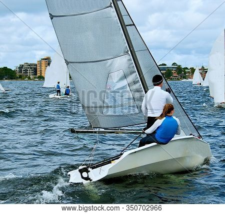 Children Sailing In High  School  Sailing  Championships.  Belmont, Lake Macquarie, New South Wales,
