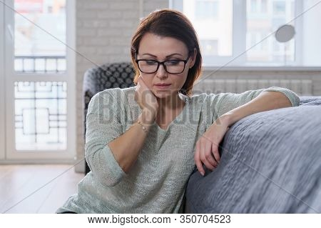 Depressed Mature Woman Sitting On The Floor At Home, Sad Middle-aged Woman Alone Experiencing Health