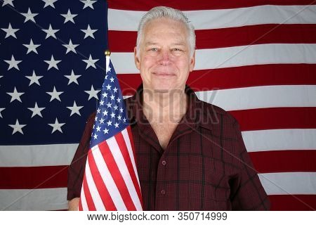 American Flag. Man Solutes the American Flag and repeats the Pledge of Allegiance. American Flag. Proud American. United States of America.
