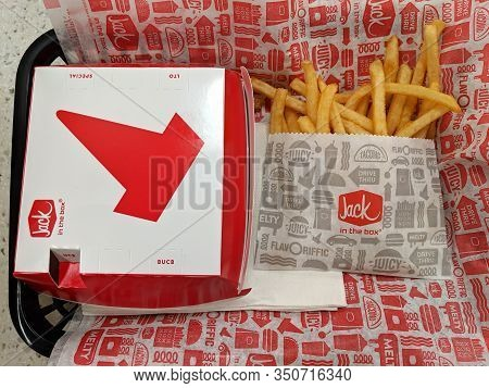 Honolulu - January 21, 2019: Jack In The Box Burger In A Box And French Fries With White Paper Napki