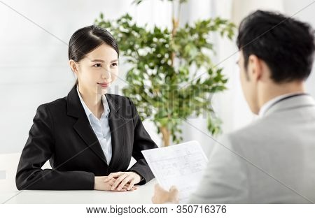 Manager Interviewing A Young  Businesswoman In Office