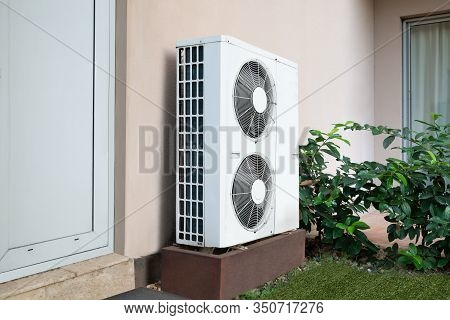 Air Conditioner Unit Standing Outside Of The House