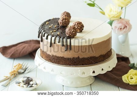 Mousse Cake Three Chocolate. A Piece Of A Mousse Cake