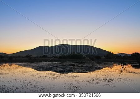 Sunset At Pilanesberg Nature Reserve Looking Over Mankwe Dam In South Africa.