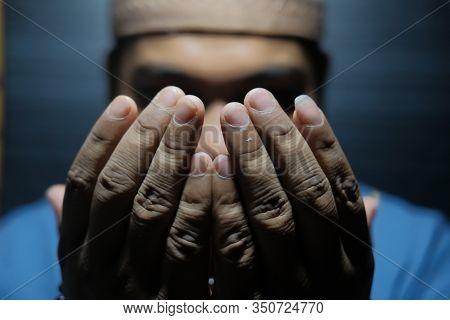 Close Up Of Muslim Man Praying At Night
