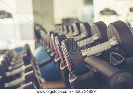 Dumbbell Weight Equipment For Exercise Tools In Weight Training. Fitness Sport Concept.