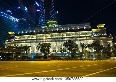 Singapore City, Singapore - April 13, 2019: The Fullerton Hotel Is A Five-star Luxury Hotel Opened I