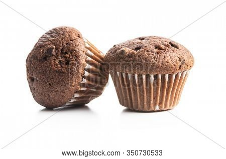 Sweet muffins. Cupcakes with chocolate isolated on white background.