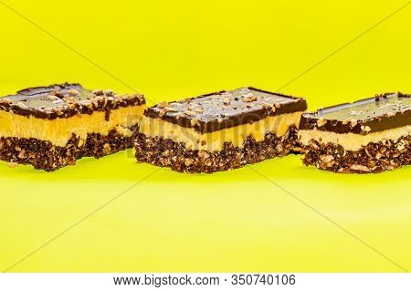 Nutty Brownie Bars On A Yellow Background
