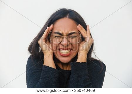 Upset Young Woman With Headache. Sad Asian Woman With Migraine Holding Hands On Temples. Headache, M