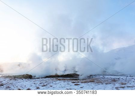 An Erupting Soaring Geyser In The Valley Of Geysers. Magnificent Iceland In The Winter