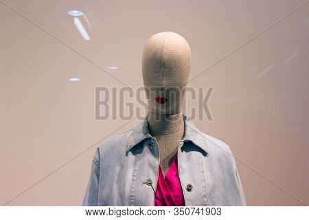 Cloth Woofed Female Mannequin In A Denim Jacket And Without Eyes. Minimalism.