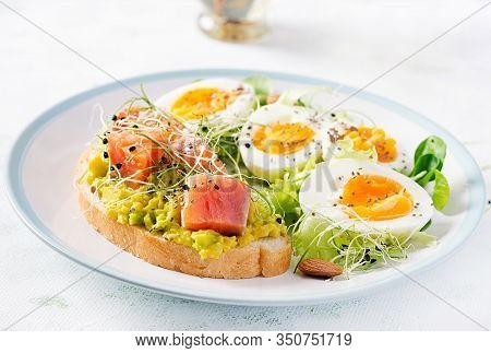 Breakfast. Healthy Open Sandwich On  Toast With Avocado And Salmon, Boiled Eggs, Herbs, Chia Seeds O