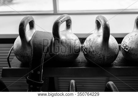 Kettlebells In A Rack At The Gym. Free Weights Close Up.