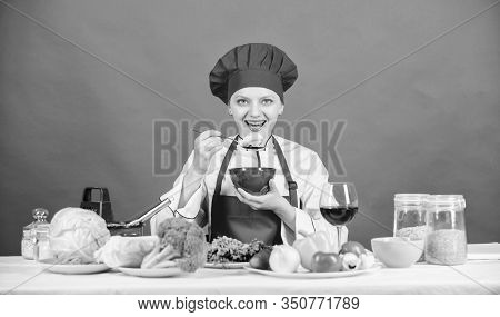 Girl Wear Hat And Apron Try Meal Taste. Woman Professional Chef Hold Bowl And Spoon. Free Healthy Ve