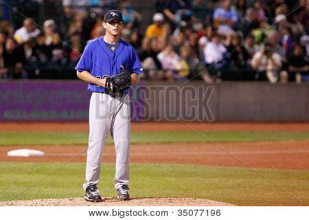 CENTRAL ISLIP-JULY 21: Sugar Land Skeeters pitcher Scott Kazmir (20) on the mound against the Long Island Ducks on July 21, 2012 at Bethpage Park in Central Islip, New York.
