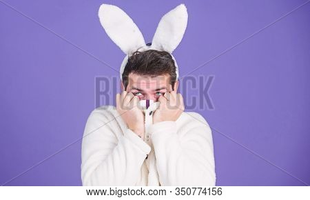 Soft And Tender. Guy With Long Bunny Or Rabbit Ears On Violet Background. Enjoy Tenderness. Cute Bun