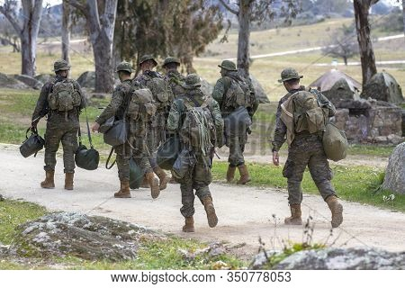 Troop Of Ground Soldiers Walking In The Field