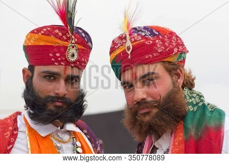 Bikaner, India - January 12, 2020: Rajasthani Handsome Men In Traditional Clothes With Beard And Lon