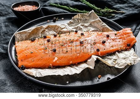Fresh Salmon Fillet With Salt, Herbs And . Black Background. Top View