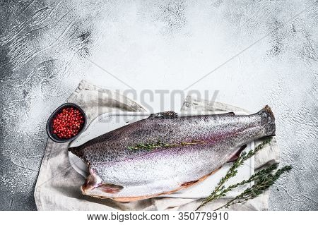 Fresh Rainbow Trout Fish Marinated With Salt And Thyme. Gray Background. Top View. Copy Space