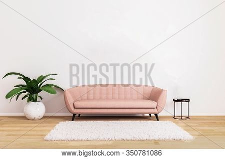 Pink Sofa With Black Coffee Table And Plant In Bright Living Room With White Wall And Wooden Floor.