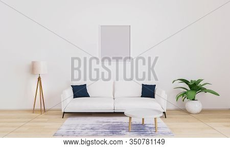 Empty Frame For Mockup. Bright Living Room With White Sofa With Dark Blue Pillows, White Modern Lamp