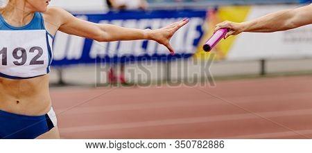 Women Relay Team Passing Of Baton In Track And Field