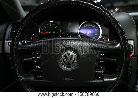 Novosibirsk, Russia - December 06, 2019:  Volkswagen Touareg, Dashboard, Player, Steering Wheel With