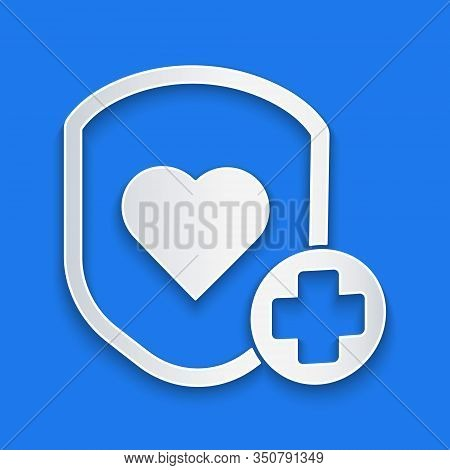 Paper Cut Shield And Heart Rate Icon Isolated On Blue Background. Health Protection Concept. Health