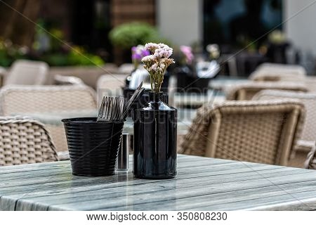 Close Up Shot Of Empty Cafeteria Or Restaurant Tables With Chairs On Street - Image