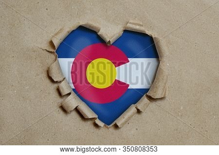 3d Illustration. Heart Shaped Hole Torn Through Paper, Showing Colorado Flag