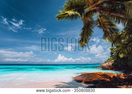 Exotic Tropical Beach. Pristine Crystal Clear Turquoise Ocean Water With Blue Sky And White Clouds.