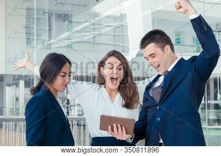 Three Good Looking Colleagues Standing In Office Corridor, Man And Woman In White Blouse Exulting, R