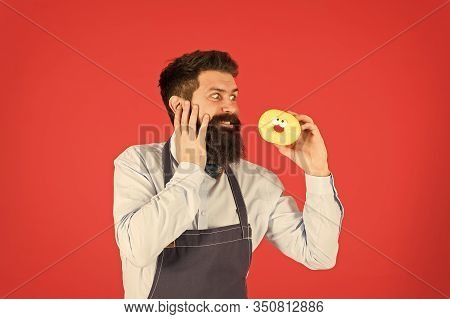 Carbs Gluten Diet. Bearded Well Groomed Man In Apron Selling Donuts. Donut Food. Hipster Baker Hold