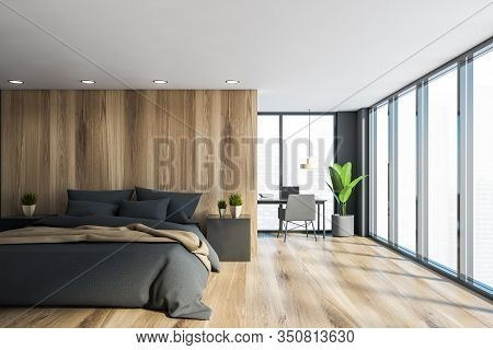 Interior Of Panoramic Master Bedroom With Grey And Wooden Walls, King Size Bed With Gray And Beige B