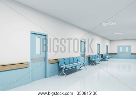 View Of White And Blue Hospital Corridor