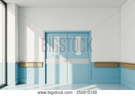 Blue Closed Door In Empty Hospital Hall