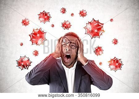 Scared Young African American Man Screaming Standing Near Concrete Wall With Virus Molecules Drawn O