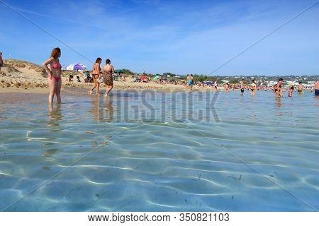 Salento, Italy - June 2, 2017: People Visit Maldives Di Pescoluse Beach In Salento Peninsula, Italy.