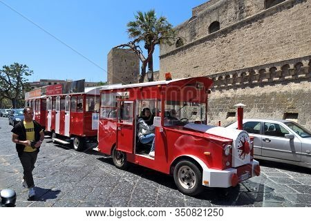 Bari, Italy - May 28, 2017: People Ride A Tourist Train In Bari, Italy. Bari Is The Capital City Of