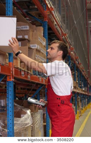 Worker Maintaining Stocks In A Storeroom