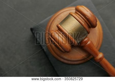 Top View Of Gavel On A Book On Back Background