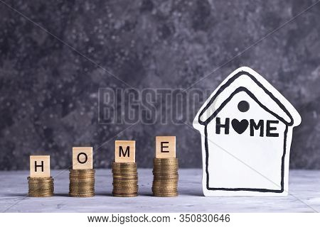Accumulating Money For Your Home On A Grey Background
