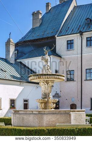 Cerveny Kamen Castle Is A 13th-century Castle In Southwestern Slovakia. Fountain In  Courtyard