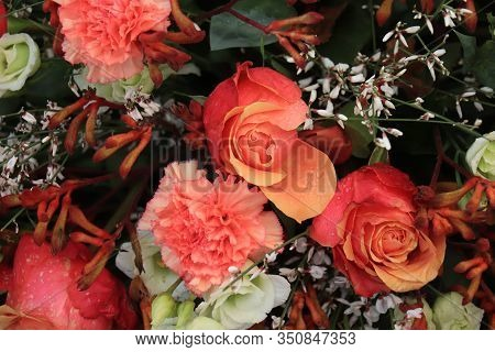 Orange Pink Roses And Carnations In A Big Wedding Centerpiece