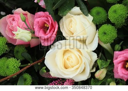 White Roses And Pink Lisianthus In A Big Wedding Centerpiece