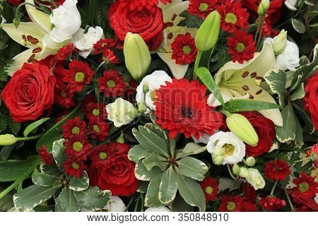 Red Roses And White Lilies In A Big Wedding Centerpiece