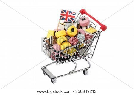 Top View Of A Shopping Cart Decorated With A Brttish Flag And Filled With Assorted Licorice Candy Is