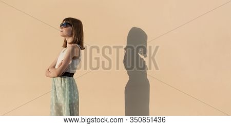 The Girl And Her Shadow Quarreled And Turned Away From Each Other.